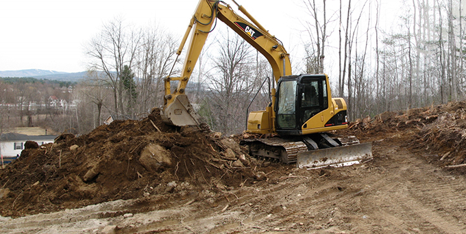 CAT Excavator relocating ground for construction